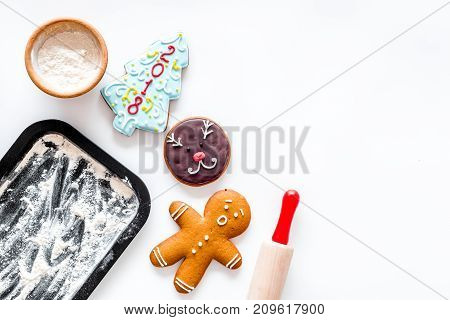 Cook gingerbread for new year 2018. Gingerbread man, rolling pin, flour on white background top view. mockup