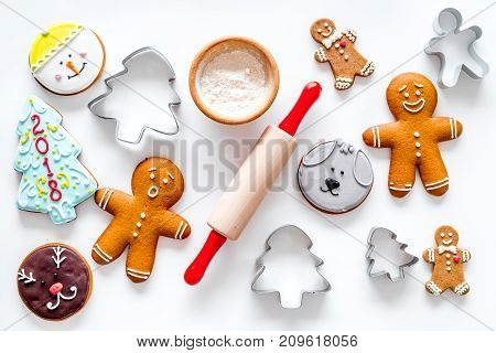 Cook gingerbread for new year 2018. Gingerbread man, rolling pin, flour on white background top view.