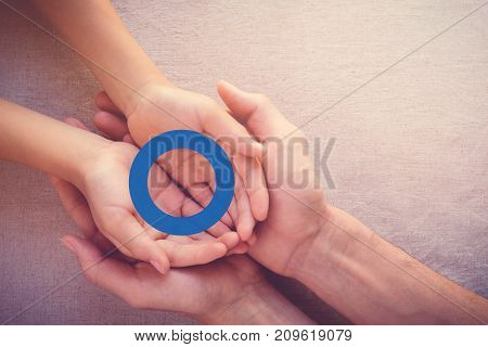 adult and child holding blue circle copy space background World Diabetes day