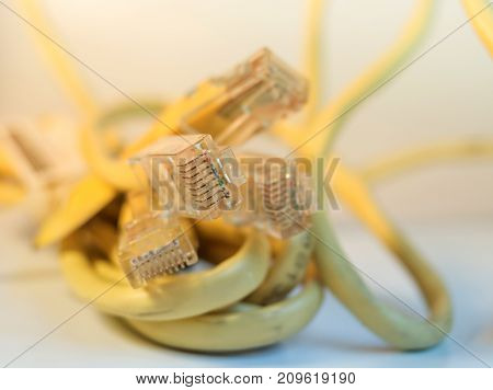 Yellow ethernet Modem cable connector isolated close up