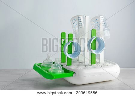 Drier with baby bottles on table