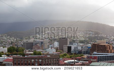 The panoramic view of Hobart downtown on a cloudy day (Tasmania).
