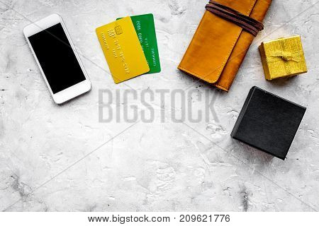 online payment for christmas present with credit card and mobile on gray stone table background top view mockup