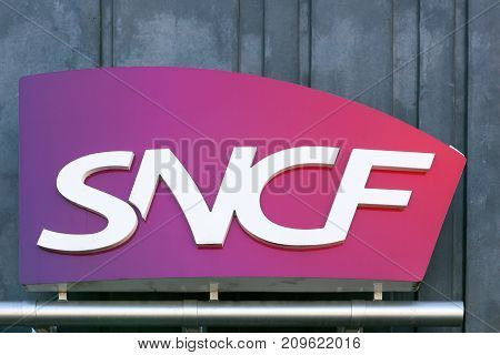 L'arbresle, France - October 11, 2017: SNCF logo on a wall. SNCF is the National society of French railway in France and it is a state-owned railway company