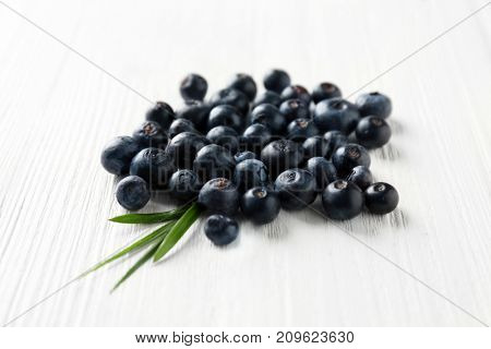 Fresh acai berries on wooden table, closeup