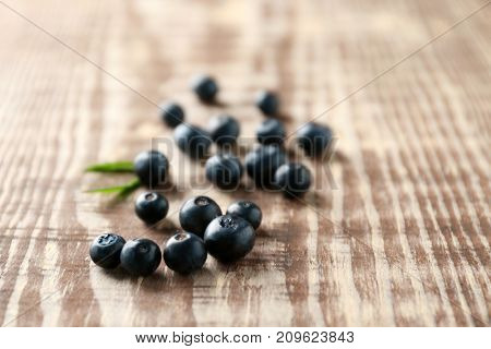 Fresh acai berries on wooden table