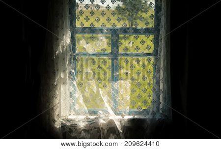 View of the garden through an old village window