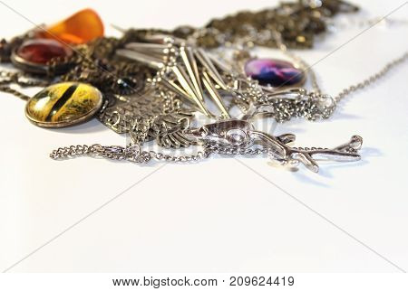 Carelessly scattered cute pendants on a white surface. Isolated
