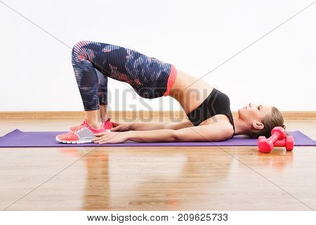 Sport Girl Doing Physical Exercises On Mat At Gym