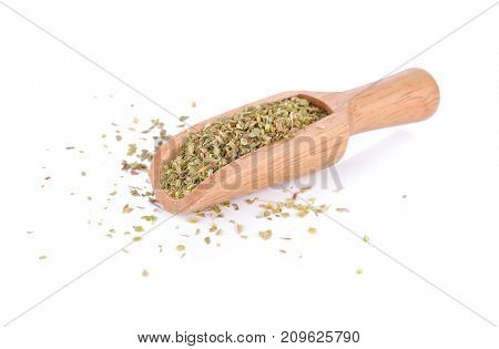 dry oregano leaves on bamboo spoon and on white background