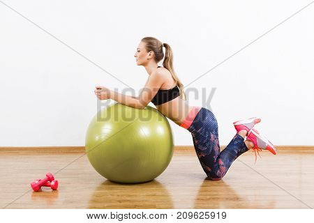 Beautiful Girl Doing Physical Exercises With Fitball At Gym