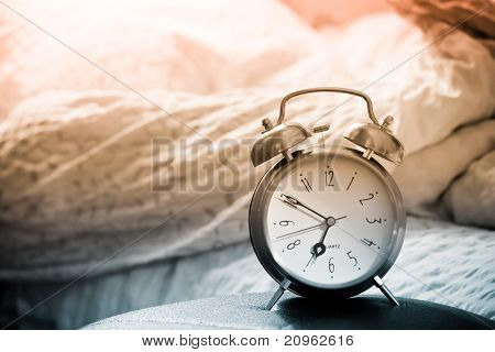 Clock And Bed Showing Wake Time In Bedroom