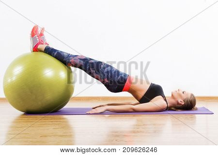 Sport Girl Doing Physical Exercises With Fitball At Gym