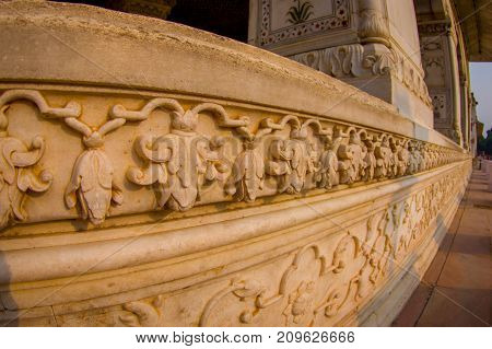 DELHI, INDIA - SEPTEMBER 25 2017: Close up of a carved wall of Inlaid marble, columns and arches, Hall of Private Audience or Diwan I Khas at the Lal Qila or Red Fort in Delhi, India, fish eye effect.