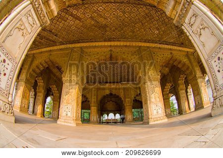DELHI, INDIA - SEPTEMBER 25 2017: Indoord view of Inlaid marble, columns and arches, Hall of Private Audience or Diwan I Khas at the Lal Qila or Red Fort in Delhi, India, fish eye effect.