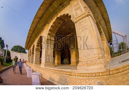 DELHI, INDIA - SEPTEMBER 25 2017: Unidentified people walking at outdoors of Inlaid marble, columns and arches, Hall of Private Audience or Diwan I Khas at the Lal Qila or Red Fort in Delhi, India, fish eye effect.