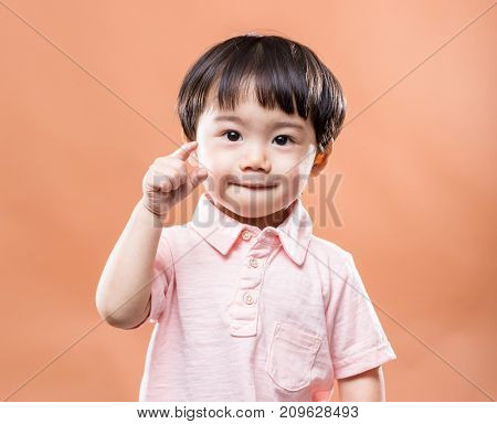 Asian baby boy finger pointing front