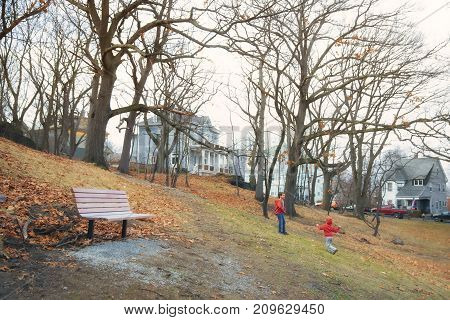 children in the autumn park. boys playing catch-up outdoors. copy space for your text