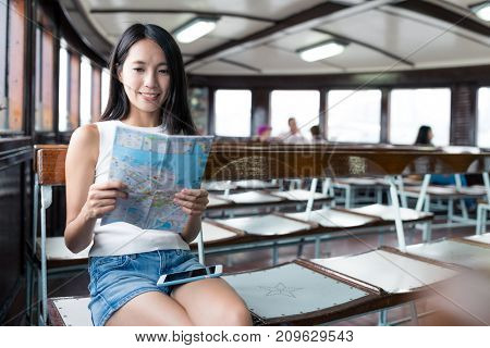 Young woman travel in Hong Kong and taking ferry