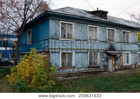 Photo of an old two-story house in disrepair
