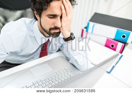 Stressed businessman in front of his laptop