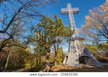 Montreal Canada - 18 October 2017: Montreal Mont-Royal Cross with fall foliage colours