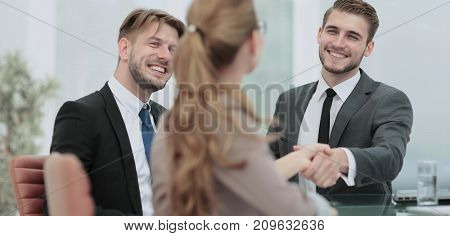 Business people closing a deal and handshaking at the office