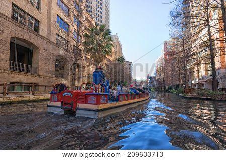 January 3, 2016 San Antonio Texas: tourits enjoying a ride on the San Antonio river on one of the many river cruises