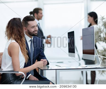 colleagues talking, sitting at your Desk