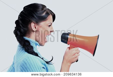 young woman speaking through megaphone