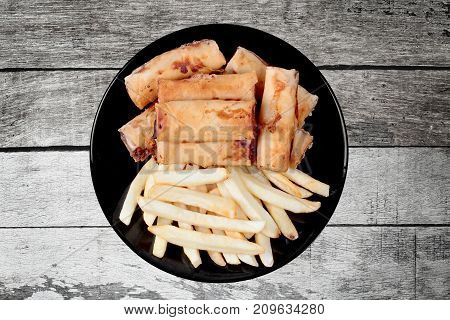Chinese Vegetable Festival Food As Deep Fried Spring Roll And French Fries Served