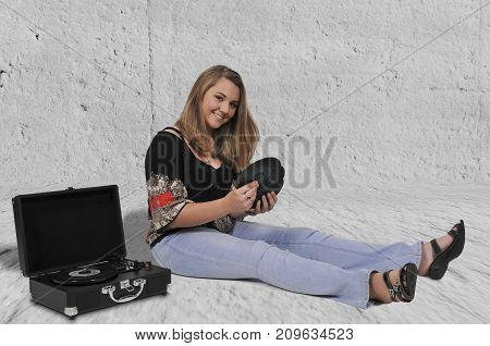 Beautiful woman with vintage 45 single record