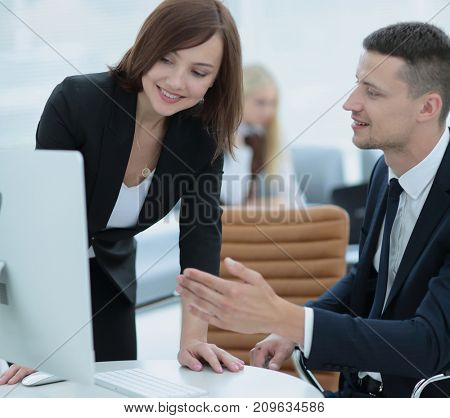 Confident business partners working in office and smiling