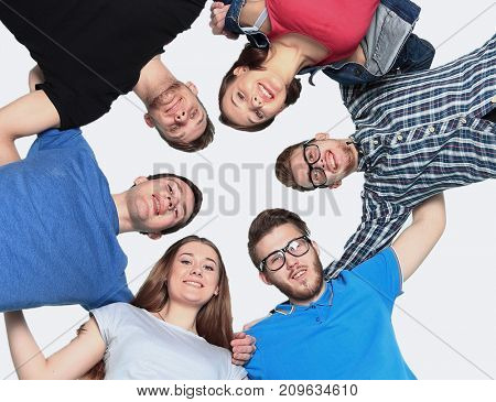 confident college students forming huddle over white background