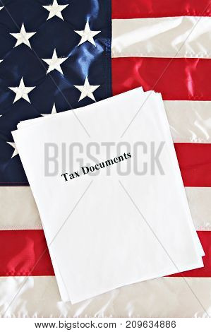 Tax Reform documents on a USA flag.