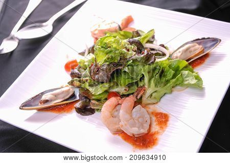 close up seafood salad on white plate