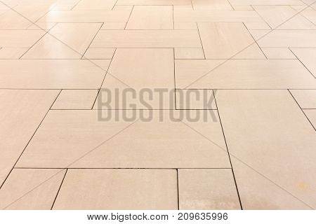 Flooring ceramic tiles of hall roomม Abstract background.