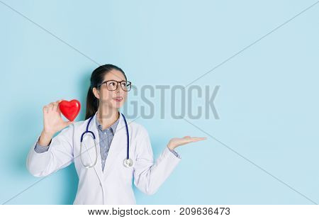 Pretty Doctor Woman Making Presenting Gesture