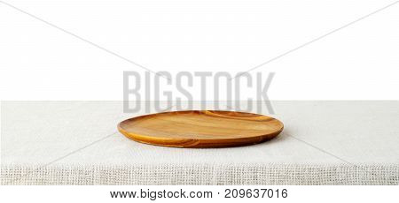 Empty wooden tray on sack tablecloth isolated on white background food display montage food background