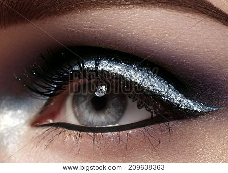 Beautiful Macro Shot Of Female Eye With Ceremonial Makeup. Perfect Shape Of Eyebrows, Eyeliner And S