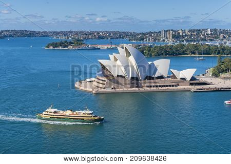 Sydney, Australia - May 16, 2017: View of Sydney Opera House with ferry passing by. It is the most popular travel destination in Sydney.
