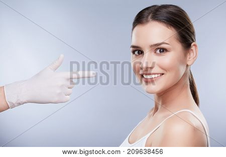 Hand In Glove Pointing At Smiling Girl