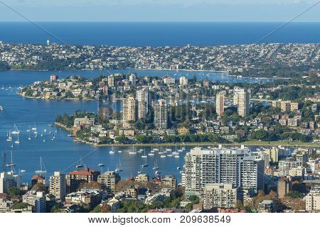 Houses and apartments in the suburbs along the shore of Sydney Harbour