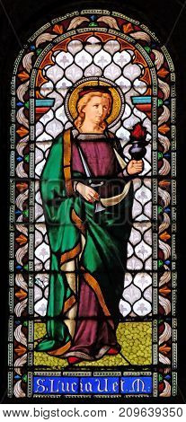 LUCCA, ITALY - JUNE 03: Saint Lucia, stained glass window in the San Michele in Foro church in Lucca, Tuscany, Italy on June 03, 2017.