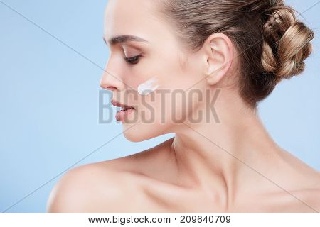 Woman With Cream On Cheek