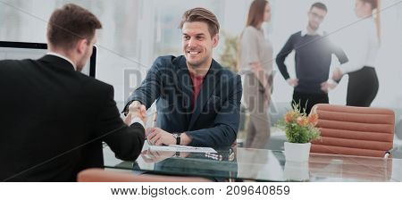 Closeup of handshake as a sign  successful cooperation and int