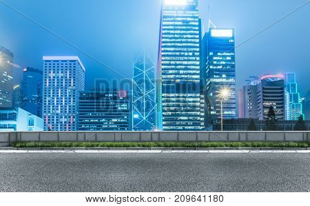 inner city street with modern skyscrapers on background,hong kong,China.