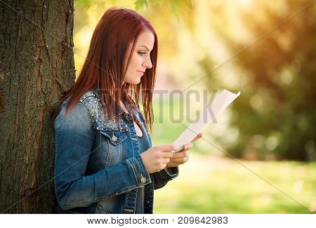 Beauty Woman Reading A Document