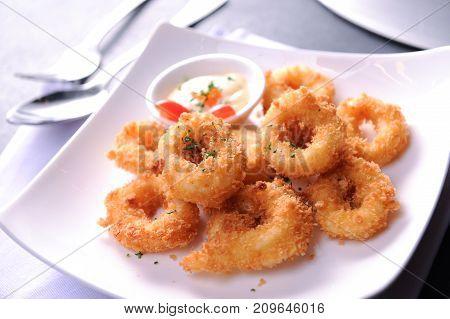 deep fried calamari squid rings on white plate