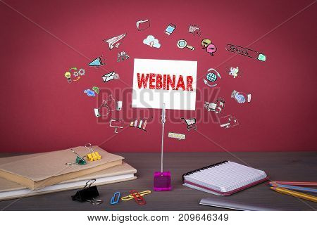 webinar concept. Wooden table at the red background.